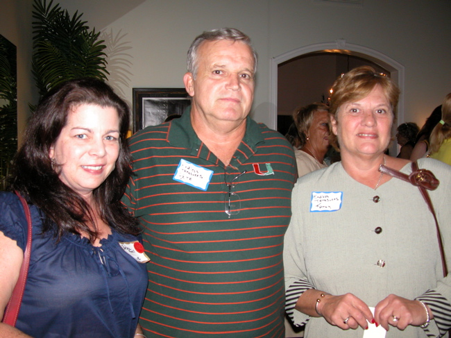 Barbara Farrell of Zavee, left, with Pete and Kathy Murphy of Endless Treasures.