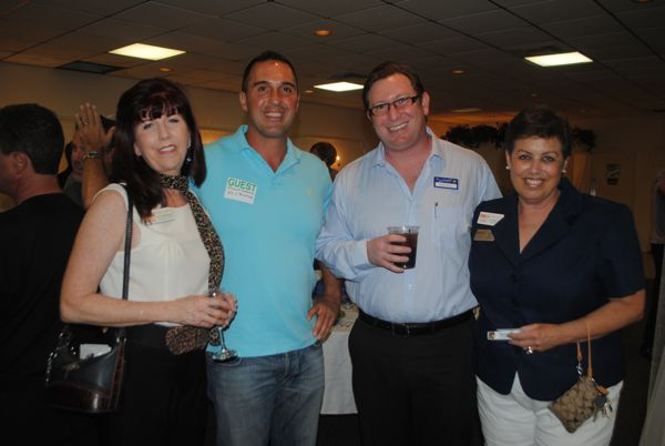 Regina O'Leary of House to Home Redesign, left, with Frank Savasta of FLS Painting Contractors, Brian Rosen of Marcus & Millichap commercial real estate and Donna Sloan of Sloan Building & Design.
