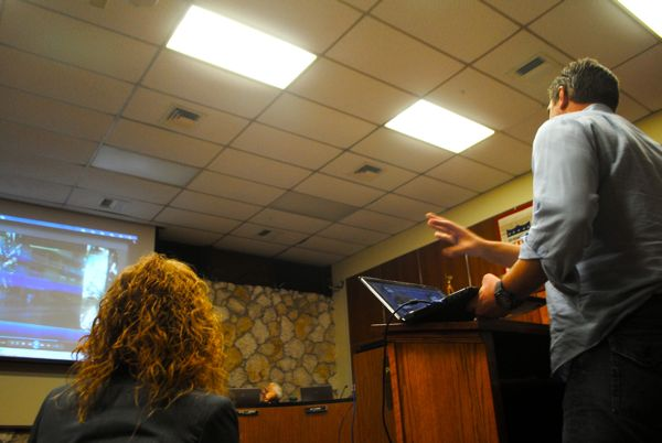 Blue Web Mobile Media CEO Daniel Kinney presents the virtual kiosk system to Delray Beach city commissioners. Tuesday evening. Downtown Marketing Cooperative Executive Director Sarah Martin looks on.