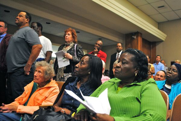 Delray Beach residents wait for their turn to speak out against the proposed fire service fee Tuesday evening.