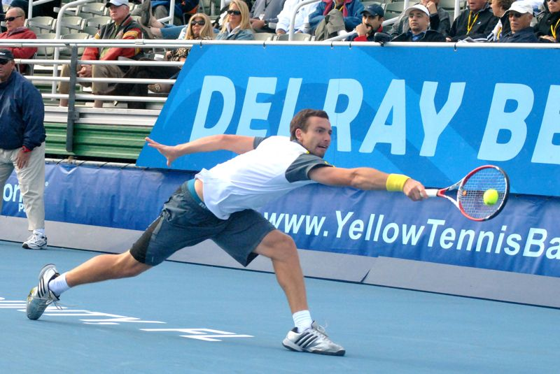 Ernests Gulbis reaches for a shot in his match Saturday against Tommy Haas.